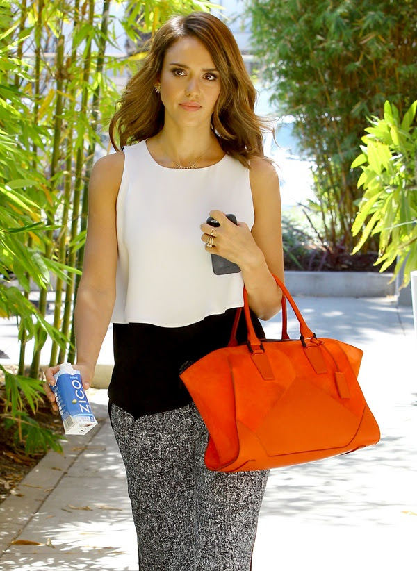 Jessica Alba heats up a simple outfit with a bright orange bag